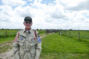 Staff Sergeant Rice of the 101st Airborne standing in front of the reenactors