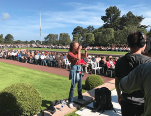 Savannah photographing the 2018 Memorial Day Ceremony at the Normandy American Cemetery