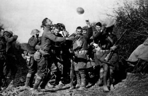 Soldiers celebrating the news of the Armistice.