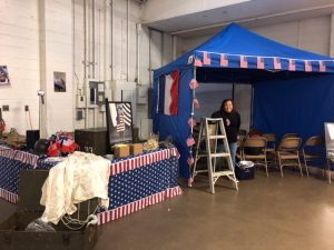 "Vicki Sullivan helping set up to show ""The Girl Who Wore Freedom"" Trailer at Peoria, IL Honor Flight Breakfast November, 2018"