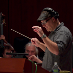 Jeff Kurtenacker, lead composer on The Girl Who Wore Freedom, conducting