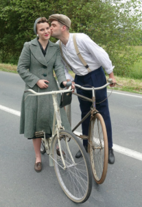 People in Normandy wearing 1940's attire