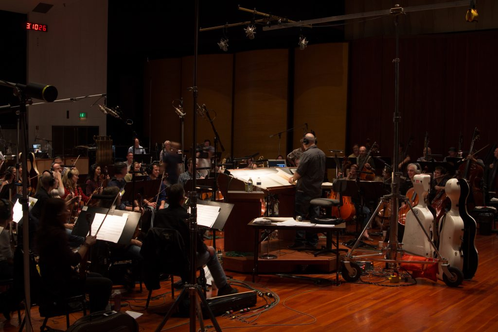 Jeff Kurtenacker, lead composer on The Girl Who Wore Freedom, conducting at Warner Brothers