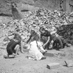 Kids playing in rubble after bombing.