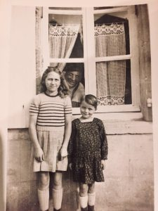 A photo of Jean Marie age 6, his sister Anne Marie and their father.