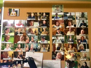 A wall of photos with names listing each person interviewed for The Girl Who Wore Freedom