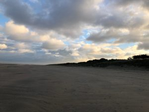 A beach in Normandy with beautiful clouds