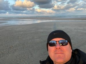 Our guest blogger on the beach in Normandy