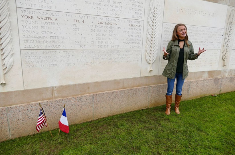 Author Savannah at a memorial in Normandy