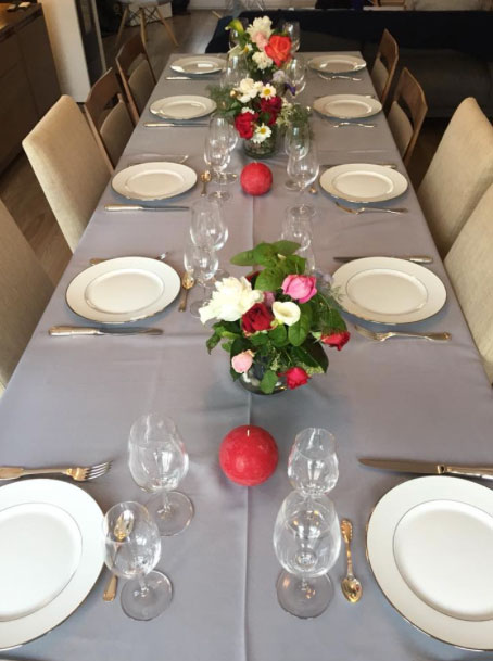 Beautiful long table with place settings for many people