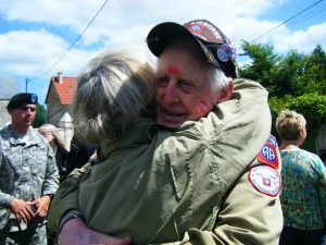 A WWII Veteran being hugged in France