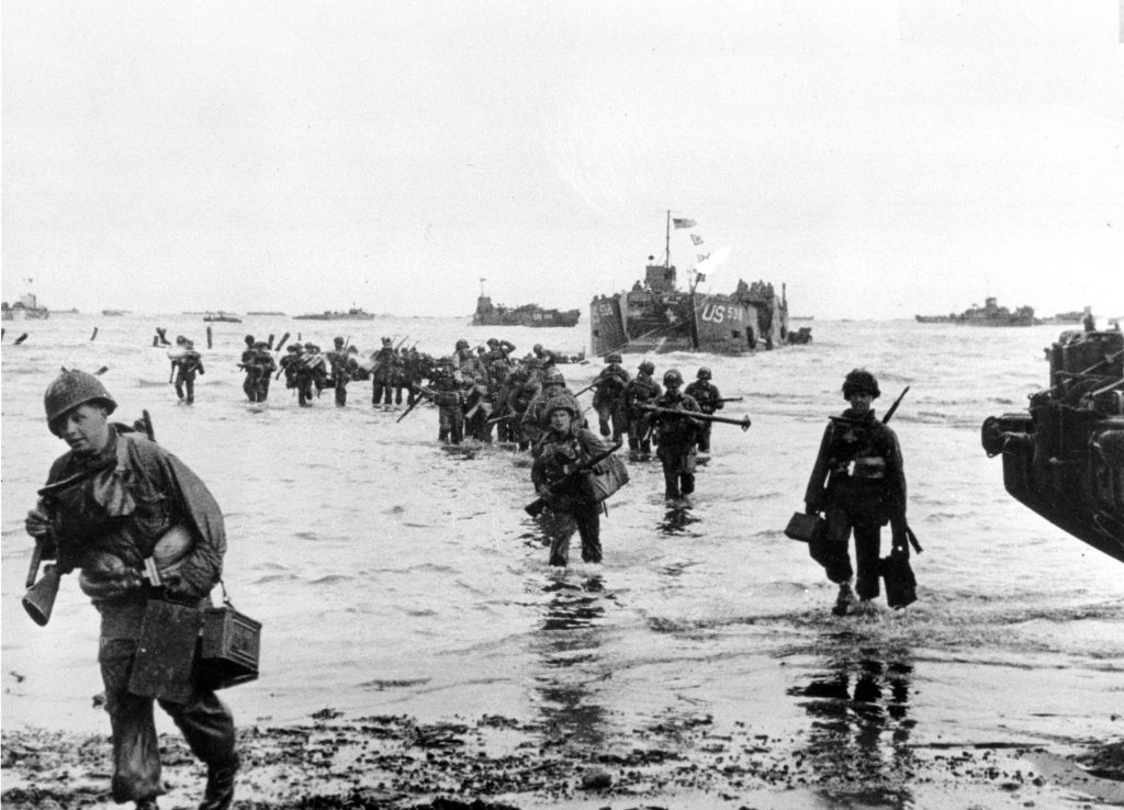 US Troops disembarking on the beaches of Normandy