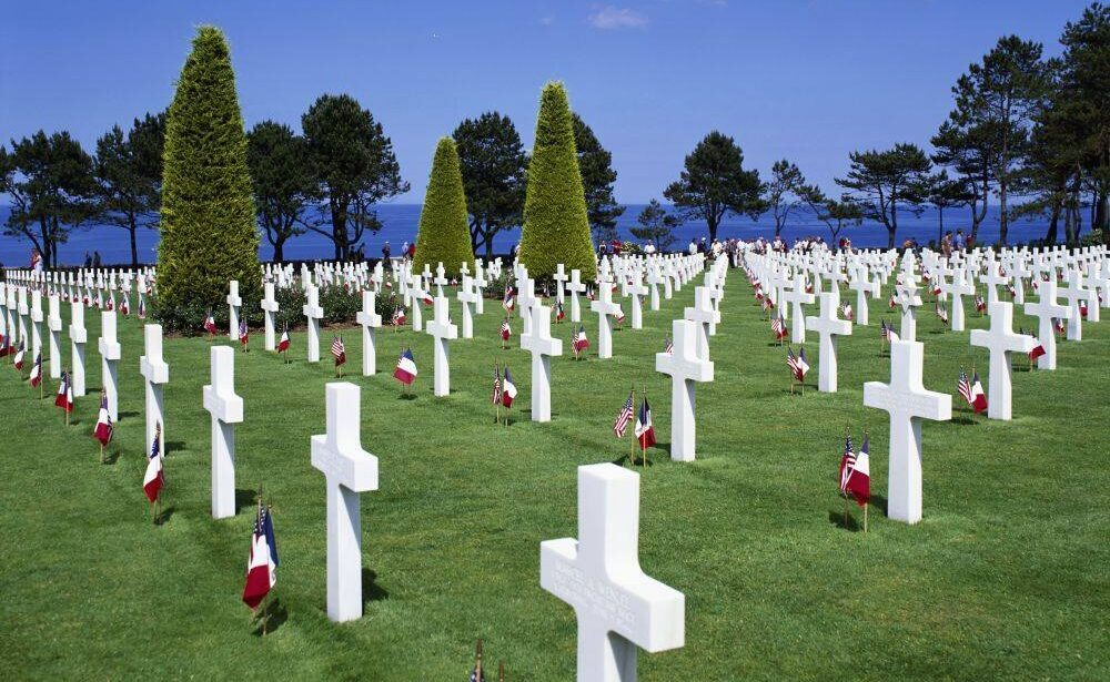 Many tombstones with flags