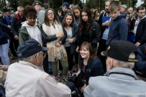Michele translating for veterans in France.